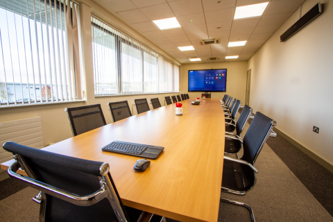Boardroom with large presentation television and table and chairs